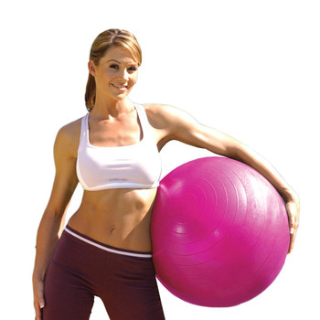 Model holding Tone Fitness Anti-Burst Gym Ball, Pink, 55 cm