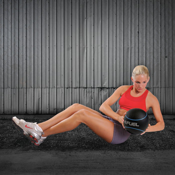 Model using Fuel Pureformance Medicine Ball, 8 lb