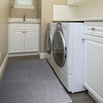 CAP 6-Piece Foam Tile Flooring with Carpet Top featured in laundry room