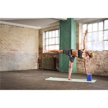 Model using blue Reebok Yoga Block