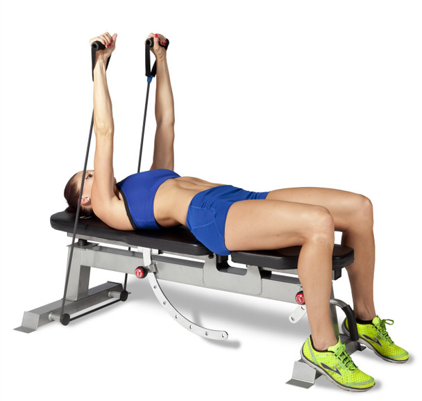 Model using resistance bands with the CAP Deluxe Utility Bench in flat position