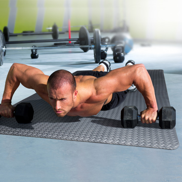 Model doing push-up presses with dumbbells on the CAP Antimicrobial EVA Foam Mat
