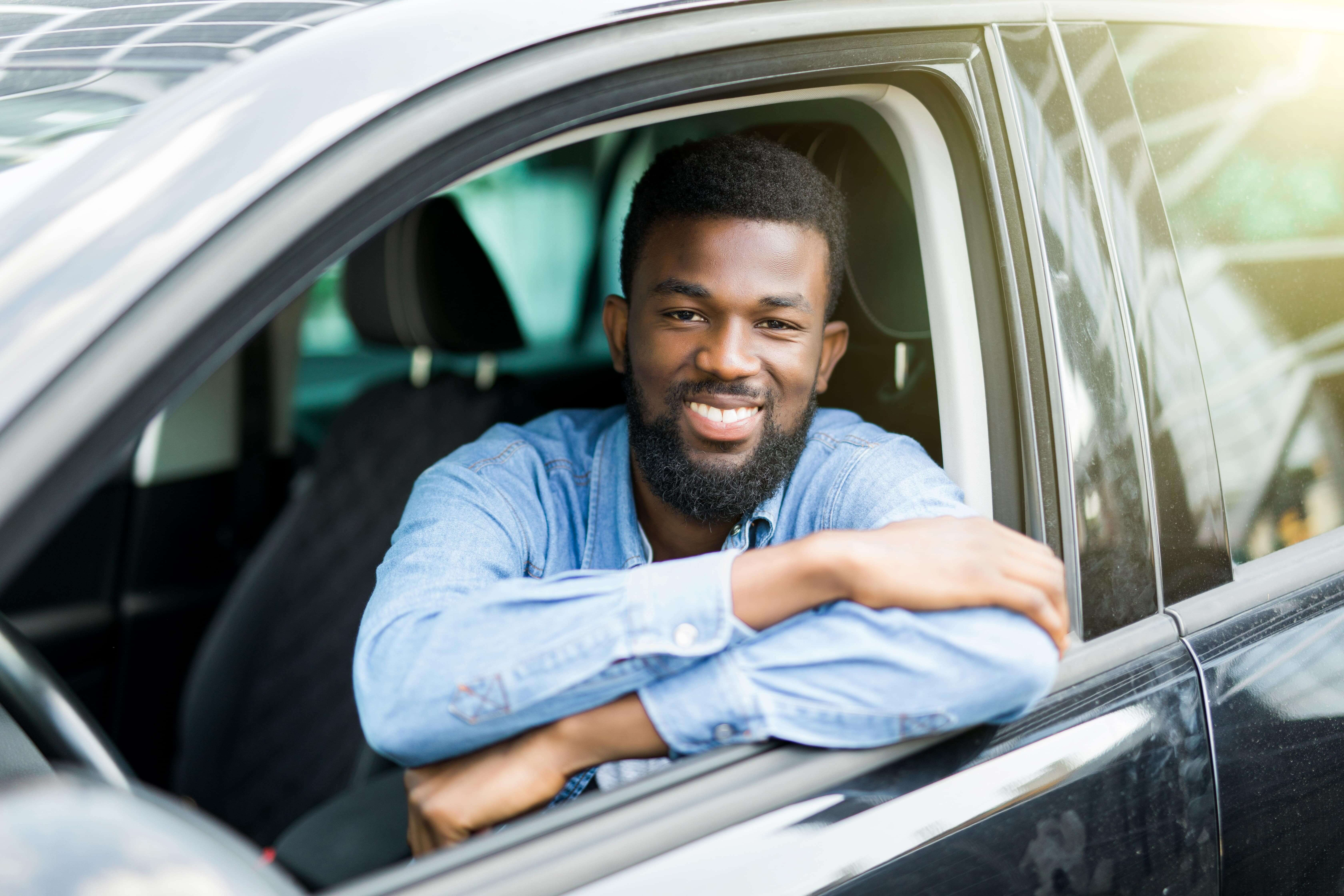 Merchant Automotive Smiling Customer