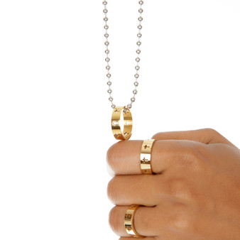 gold cross ring on silver necklace and gold cross rings on fingers