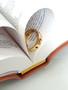 Gold Cross ring in open bible