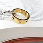 gold cross ring on silver necklace on bible