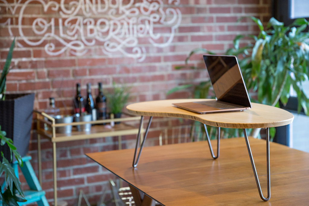 Flow Desk, Tria in Natural Bamboo used as a standing desk.