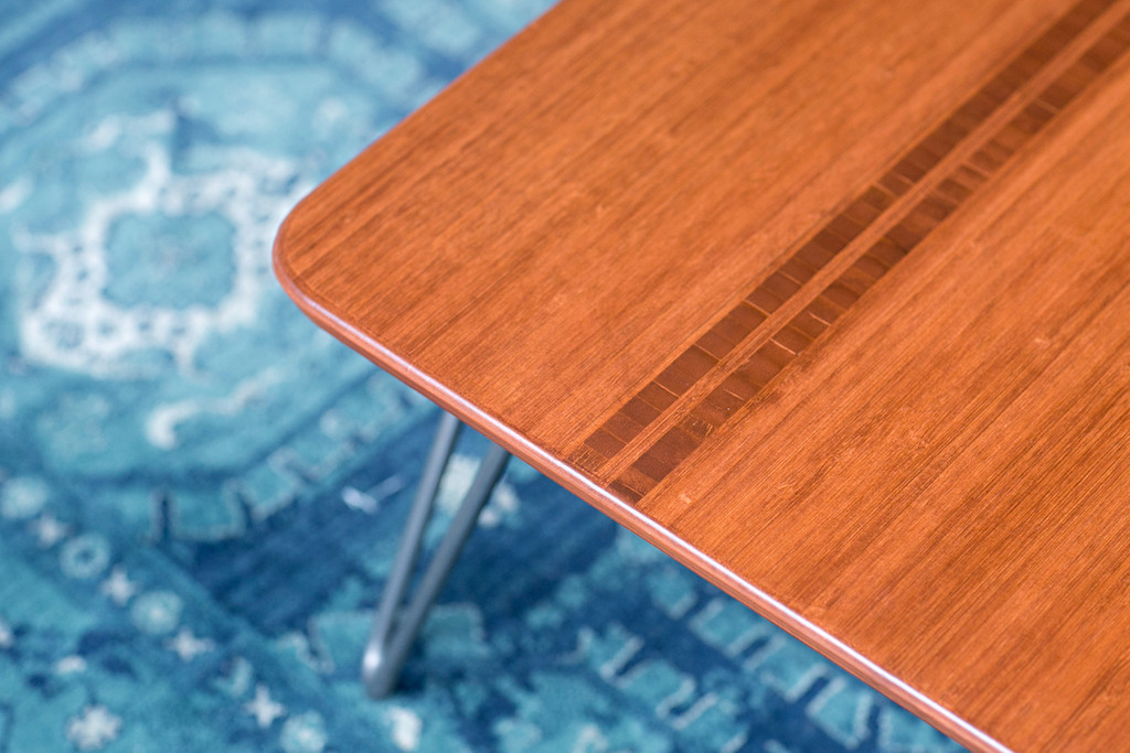 Closeup of inlay in Flow Desk, Tessera with Amber Bamboo Finish