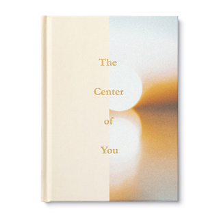 A hardcover encouragement book with the title The Center of You. Features a moving photograph, a Wibalin spine and gold foil on the cover.