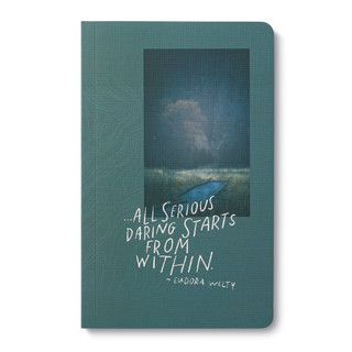 """A softcover journal with landscape photography and a motivating quote. The cover features a photo of a walking path in a forest and the quote """"…all serious daring starts from within."""" —Eudora Welty."""