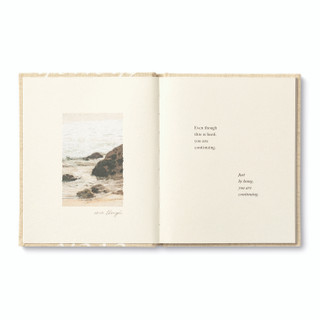"""Inside pages, """"Even Though"""", an encouragement book with a calming, neutral cloth cover design, written by M.H. Clark, inside page copy """"even though this is hard, you are continuing. Just by being, you are continuing"""" and includes a photo of a rocky ocean shore"""
