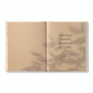 """Inside pages, """"Even Though"""", an encouragement book with a calming, neutral cloth cover design, written by M.H. Clark, inside page copy """"You have known moments of calm, and you will know them again, and the season will shift, even though you may not know when."""" and includes a light shadow image of leaves"""