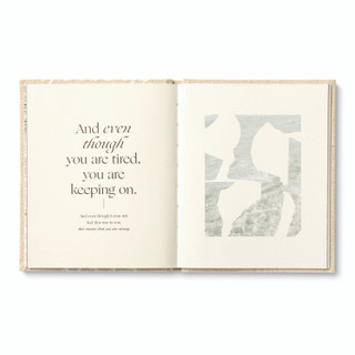 """Inside pages, """"Even Though"""", an encouragement book with a calming, neutral cloth cover design, written by M.H. Clark, inside page copy """"And even though you are tired, you are keeping on. And even though it may not feel this way to you, this means that you are strong."""" and includes an image of  calm water with organic shapes overlayed"""