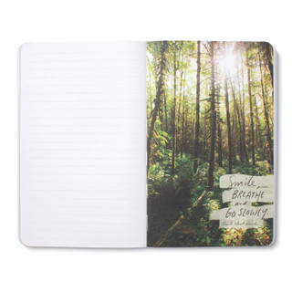 """Inside pages, nature-themed journal with 8 breakout pages, each featuring vibrant photography of the natural world with inspiring quotes, this page features a light filled forest scene with the quote """"Smile, breathe, go slowly."""" -Thich Nhat Hanh"""