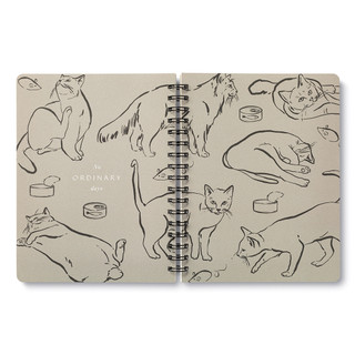 """Inside pages, cat themed, black and cream colored wire-o notebook, includes 3 breakout spreads, each with a unique design, this breakout spread features a cat throughout the day, with the statement """"No ordinary days"""""""