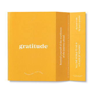 """Extended cover feature, includes bookmark, bright orange softcover, activity journal, """"True Gratitude"""", a collection of exercises, prompts, vignettes, and quotes"""