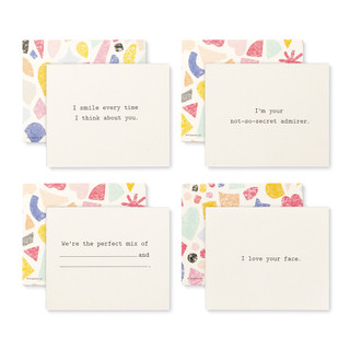 """Front and back view of four cards, a playful set of compliment cards for someone special, bright and colorful sleeved box, features elegant gold foil stamping, includes 20 cards, each with a unique messages. Messages on this set of 4 cards includes, """"I smile every time I think about you"""", """"I'm your not-so-secret admirer"""", """"We're the perfect mix of BLANK and BLANK"""", """"I love your face""""."""