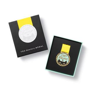 """Open box view,  an award medal with a yellow ribbon and an illustration that reads """"Cat Lover."""", includes keepsake gift box, black slip cover with medal image in cover, medal sits securely in tray box"""