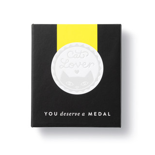 """Front box view,  an award medal with a yellow ribbon and an illustration that reads """"Cat Lover."""", includes keepsake gift box, black slip cover with medal image in cover, medal sits securely in tray box"""