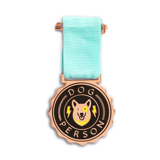 """An award medal with a teal blue ribbon and an illustration that reads """"Dog Person"""""""