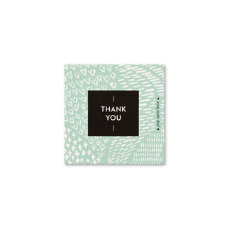 """Front view of a pop-open card, """"Thank You"""",  light green and white, elegant design, 30 pop-open cards, each with a unique message inside, back of cards has space to write a note"""