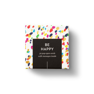"""Top view of box, """"Be Happy"""", confetti, colorful design, 30 pop-open cards, each with a unique message inside, backside has space to write a note"""