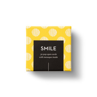 """Top view of box, """"Smile"""", bright, yellow, fun design, 30 pop-open cards, each with a unique message inside, backside has space to write a note"""