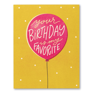 """Card front, mustard-colored birthday card featuring an illustration of a balloon and the statement """"Your birthday is my favorite."""""""