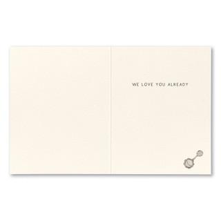 "Card inside,  ""We love you already."""
