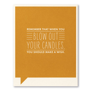 """Card front, orange birthday card with the statement """"Remember that when you blow out your candles, you should make a wish."""""""
