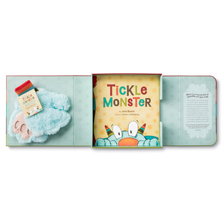 Tickle Monster Laughter Kit opened with book and mitts inside.