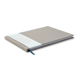 """Front of """"In Memory Of..."""" a memorial guest book with bellyband."""