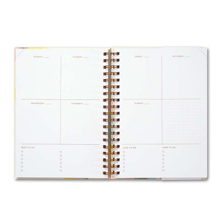 Inside of Something Wonderful Is About to Happen, a 17-month undated planner.