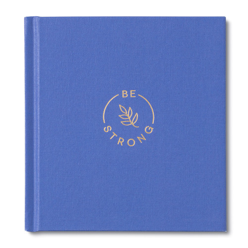 A blue hardcover encouragement book with the title Be Strong. The cover shows a leaf in gold foil.