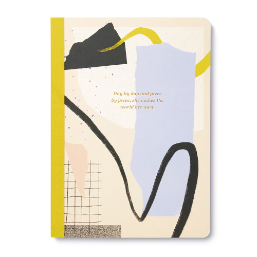"A colorful, artistic composition notebook. The cover features the statement, ""Day by Day and Piece by Piece, She Makes the World Her Own."""