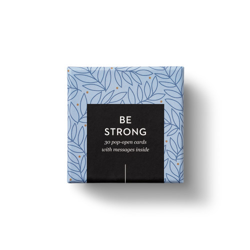 """Top view of box, """"Be Strong"""", blue and gold leaf design, 30 pop-open cards, each with a unique message inside, backside has space to write a note"""