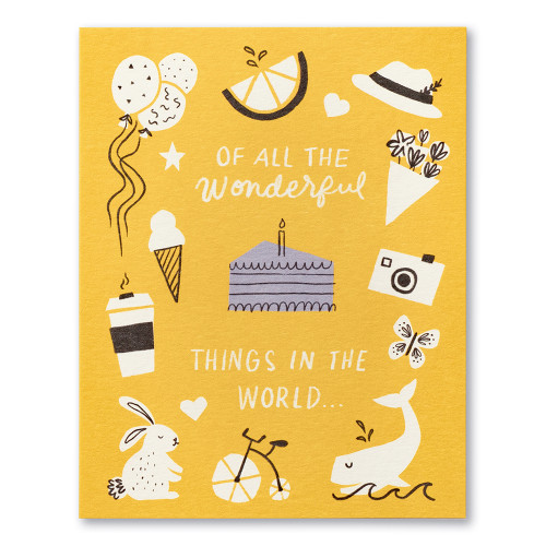 """A yellow birthday card that says """"Of all the wonderful things in this world…"""" It features illustrations of a rabbit, whale, balloons, camera and coffee."""