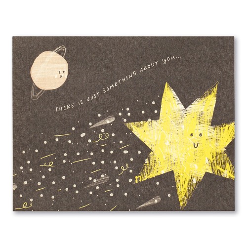 """This love card features a textured illustration of a sun and planet with smiley faces. The statement reads """"There is just something about you…"""""""