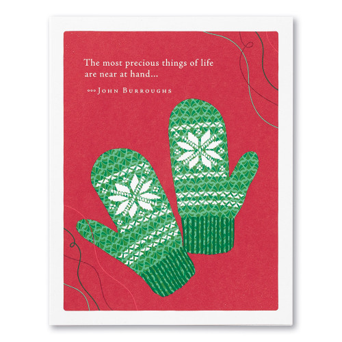 "A red holiday card featuring an illustration of two knitted mittens and the quote ""The most precious things of life are near at hand..."" —John Burroughs."