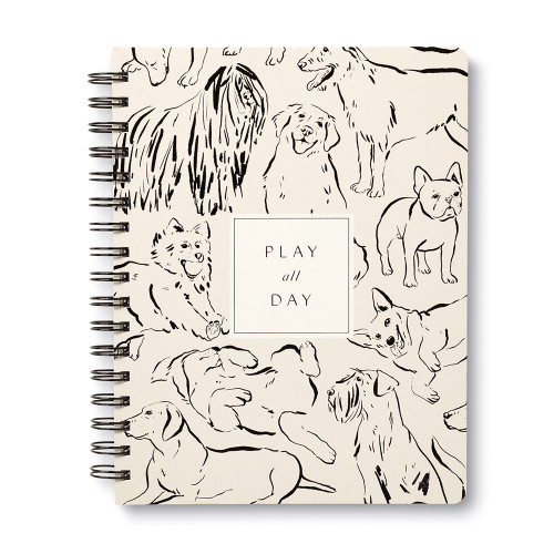 """Front cover, dog themed, black and cream colored wire-o notebook, the cover features illustrations of joyful dogs with the statement """"Play all Day"""", illustrations include a variety of dog breeds, includes 3 breakout spreads, each with a unique design"""