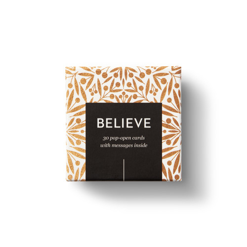 """Top view of box, """"Believe"""", gold and black box design, 30 pop-open cards, each with a unqiue message inside, backside has space to write a note"""