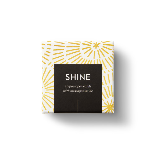 """Top view of box, """"Shine"""", gold burst, sunshine design, 30 pop-open cards, each with a unique message inside, backside has space to write a note"""