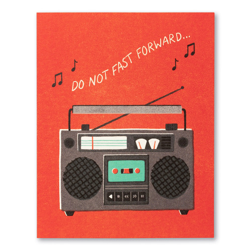 """A bright red birthday card featuring an illustration of a boombox and the statement """"Do not fast forward. """""""