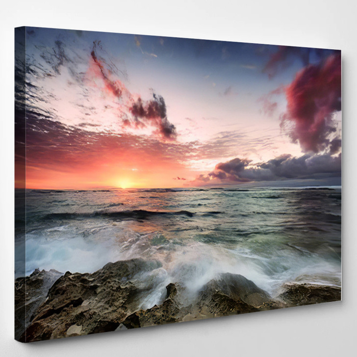 A Cloudy Sunset As Waves Crash Over Rocks - Nature Canvas Wall Art