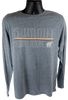 """Front view of heathered dust blue long sleeve cotton tee with large retro """"Summit"""" lettering in white outline, above the horizontal lines (yellow, white, red) and outlined """"bechtel reserve"""" in more white outline, with a white black bear silhouette."""