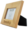 angled view of 4x6 picture frame with thick wooden borders and engraved Summit logo centered on the bottom, which shows black back piece to prop up the frame.