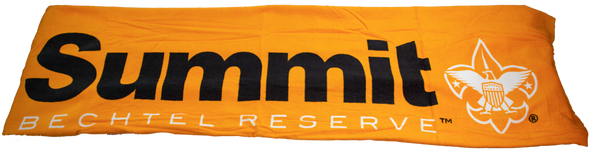 Unrolled orange beach towel with Summit logo in black and white