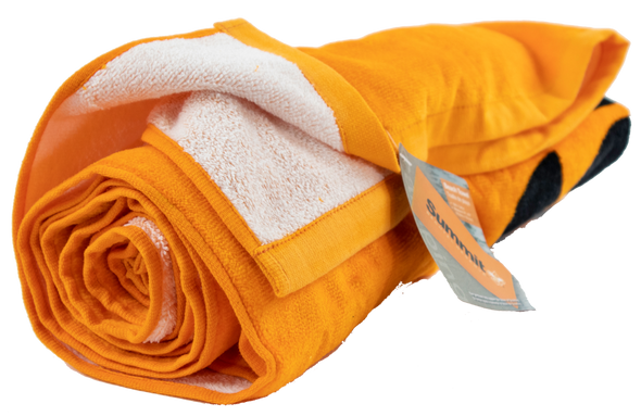 Rolled shot of orange beach towel