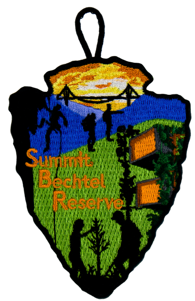 "arrowhead-shaped patch with silhouette depictions of various high adventure activities: on the left a repeller, on the bottom two people examining a tree, in the middle two people hiking. The top shows the side wings of the consol energy bridge in sillhouette over a yellow sky, and the bottom has a green background with the sustainability treehouse on the left. ""Summit Bechtel Reserve"" lettering in the left-center"