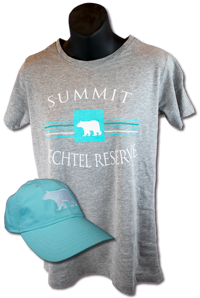 "heathered gray ladies fit tee with white arched ""Summit"" lettering above baby blue bear icon on top of and horizontal lines, and mirrored arched ""Bechtel reserve"" lettering underneath. On top of the tee is a superimposed baby blue hat with large white embroidered black bear silhouette."